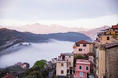 Free Panoramic Top View Of Alps Mountains In Fog And Clouds Royalty Free Stock Image - 138031266