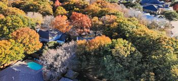 Panoramic top view residential houses with garden, garage and colorful leaves near Dallas. Panorama aerial view residential neighborhood with colorful fall royalty free stock images