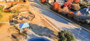 Panoramic top view residential playground with colorful fall lea royalty free stock images
