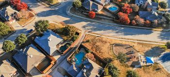 Panoramic top view residential playground with colorful fall lea stock photos
