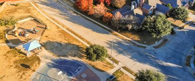 Panoramic top view residential playground with colorful fall lea royalty free stock photo