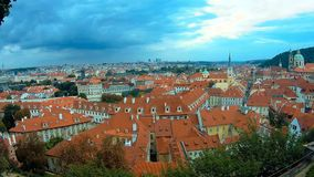 Panoramic top view to red tile roofs of Prague city Czech republic. Typical Prague houses. Petrshin hill and tower stock footage