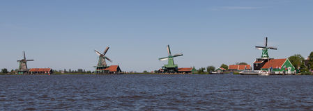 Panoramic of traditional Dutch windmills Stock Photos