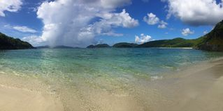 Panoramic of tropical Caribbean beach with distant clouds Royalty Free Stock Photos