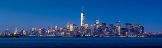 Panoramic twilight view of Lower Manhattan from New York City Harbor Royalty Free Stock Image