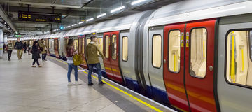 Panoramic underground. LONDON - APRIL 15: Inside view of London underground on April. 10, 2015 in London, UK. London's system is the oldest underground railway Stock Images