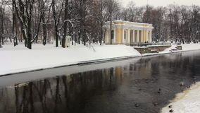 Panoramic of Unfrozen Moika river, St Petersburg. Panorama of Unfrozen Moika river and the park of the Russian Museum in winter, St. Petersburg, Russia stock video footage