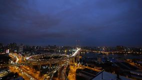 Panoramic of urban busy freeway interstate traffic at night,shipping on river. stock video