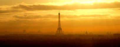 Panoramic vie, Sunrise over Paris (France). Panoramic view of Paris at the sunset. You can see the main touristic building of the romantic city: the eiffel tower Royalty Free Stock Photo