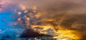 Panoramic view on сloudy sky at sunset. clouds are colored by a sunset gradient. Panoramic view on сloudy sky at sunset. Сirrus clouds are colored by a royalty free stock images