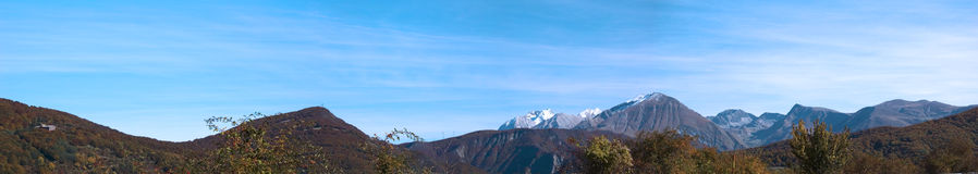 Panoramic view. Mountains landscape in autumn, panoramic view with blue sky in the background stock image