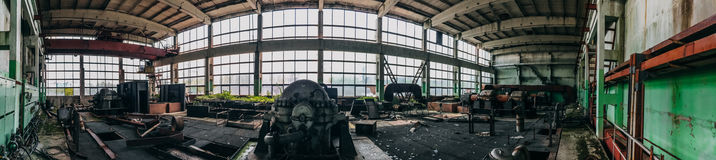 Panoramic view of abandoned industrial factory interior, Large workshop stock images