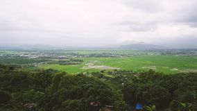 Panoramic view from above on a beautiful, sunny stormy valley with passing train. Vietnam. Time lapse stock video