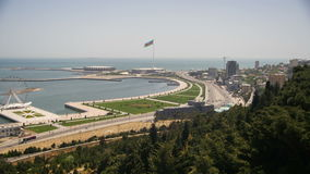 Panoramic view from above on a big city near the sea. Baku, Azerbaijan. Time Lapse. Traffic of cars on roads. View from above on the embankment, the Caspian stock video footage