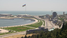 Panoramic view from above on a big city near the sea. Baku, Azerbaijan. Time Lapse. Traffic of cars on roads. View from above on the embankment, the Caspian stock video
