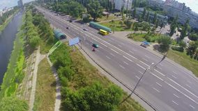 Panoramic view from above on city road and river channel. Stock footage stock video footage