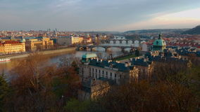 Panoramic View Above Prague city. With Old Architecture and Vltava River with Bridges at sunset stock video footage