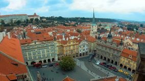 Panoramic view from above of the roofs of buildings and Church of St. Thomas in Prague from the top of St Nicholas Bell stock footage