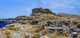 Panoramic view of Acropolis of Lindos and the bay below the rocks Royalty Free Stock Photos
