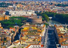 Panoramic view from the air to city, Castel Sant'Angelo, Saint Peter`s Square, Rome, the Tevere Tibr River and mountains, Italy. Panoramic view from the royalty free stock photography