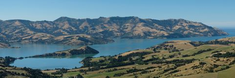 Panoramic view of Akaroa, Banks Peninsula, Christchurch New Zealand. Photo taken on a clear summer`s day. stock photo