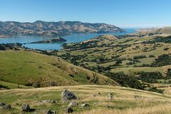 Panoramic view of Akaroa, Banks Peninsula, Christchurch New Zealand. Photo taken on a clear summer`s day. royalty free stock images