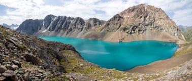 Panoramic view of Ala-Kul lake in Kyrgyzstan Royalty Free Stock Photography