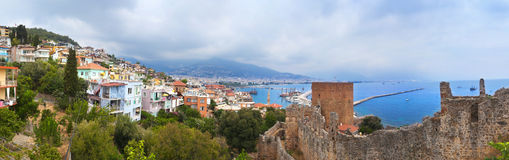Panoramic view of Alanya harbor and ancient stone wall of Alanya Castle Stock Image
