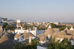 Panoramic view of Alberobello (Apulia, Italy). Panoramic view of Alberobello at sunset. The white-painted trulli houses of Alberobello are protected under the Stock Photography