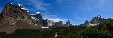 A panoramic view along the pathway leading up the French Valley in Torres del Paine National Park, Patagonia. A panoramic view along the pathway leading up Royalty Free Stock Photo