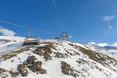 Panoramic view of an alpine mountainside with ski lift Stock Photo