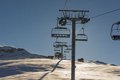 Panoramic view of an alpine mountainside with ski lift Stock Photos