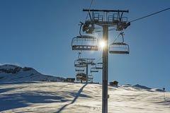 Panoramic view of an alpine mountainside with ski lift Stock Photos