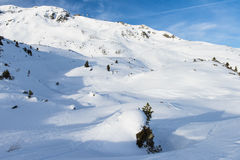 Panoramic view of an alpine snowy mountain Royalty Free Stock Images