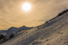 Panoramic view of an alpine snowy mountain in the sun Stock Image