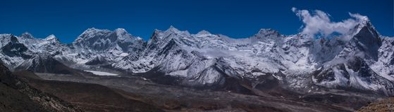 Panoramic view of Ama Dablam peak and Island peak royalty free stock images