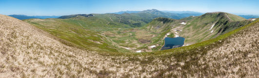 Panoramic view of amazing mountain valley with lake Royalty Free Stock Image
