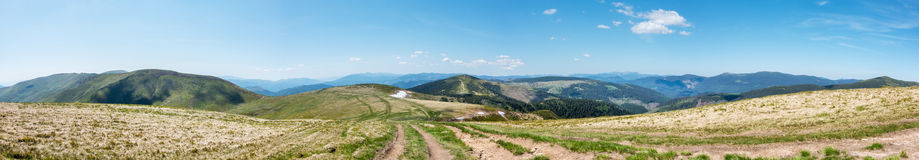 Panoramic view of amazing spring mountains with roads Royalty Free Stock Images