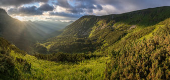 Panoramic view of amazing sunrise over mountain valley Stock Photo