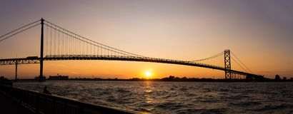 Panoramic view of Ambassador Bridge connecting Windsor, Ontario. To Detroit Michigan at sunset time Stock Image