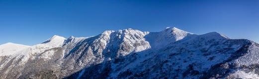 Panorama of snowy mountains Royalty Free Stock Photos