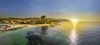 Ouranoupolis Tower on Athos peninsula in Halkidiki. Panoramic view of a Ancient Athos, Ouranoupolis Tower on Athos peninsula in Halkidiki, Greece during sunset royalty free stock image