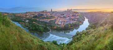 Panoramic view of ancient city and Alcazar on a hill over the Tagus River, Castilla la Mancha, Toledo, Spain Royalty Free Stock Photography