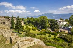 Panoramic view of the ancient city of Pompeii with gardens and streets. Pompeii is an ancient Roman city died from the eruption of. Ancient ruins in Pompeii Royalty Free Stock Photos