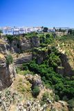 Panoramic view on ancient village Ronda located precariously close to the edge of a cliff in Andalusia, Spain stock image