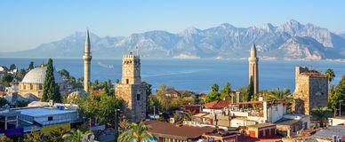 Panoramic view of Antalya Old Town, Turkey. Panoramic view of Antalya Kaleici Old Town with the Clock Tower, Yivli Minaret, Tekeli Mehmet Pasa mosque Royalty Free Stock Images