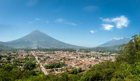 Panoramic view of Antigua Guatemala. City view of Antigua Guatemala from Cerro de La Cruz with Agua Volcano in the background stock photos