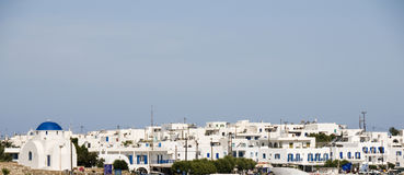 Panoramic view antiparos cyclades island greece. Panoramic view of the port town of antiparos island with shiny white cyclades building in the greek island royalty free stock image