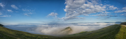 Panoramic view of Apennines in a foggy day, mount Cucco, Umbria, Italy Royalty Free Stock Photography