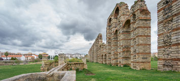 Panoramic view of aqueduct of the Miracles in Merida, Spain. Ultra wide panoramic view of Aqueduct of the Miracles in Merida against cloudy sky, Spain Royalty Free Stock Images